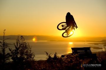 Dylan Dunkerton jumping into the sunset on the Sunshine Coast, B